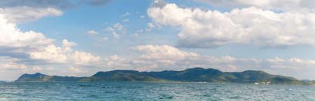Panoramic view of Ira island with white beacon and Kram Yai Island in the background. Beautiful seascape of Chonburi province, Thailand. Stock Photo