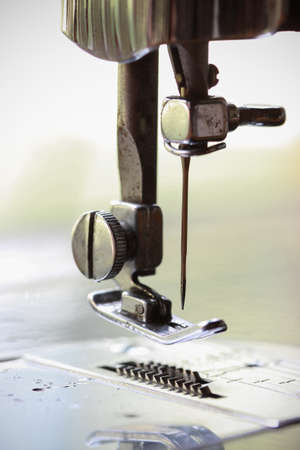 sewing pattern: the sewing machine and item of clothing, Detail of sewing machine and sewing accessories, old sewing machine. Stock Photo