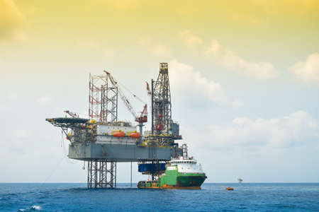 offshore jack up rig: Oil and rig platform operation in north sea, Heavy industry in oil and gas business in offshore, rig operation.