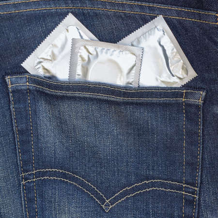 jeans and a condom in his back pocket  photo