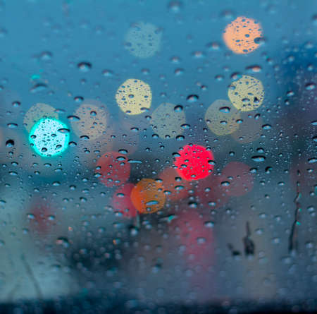 rain drops on car glass photo