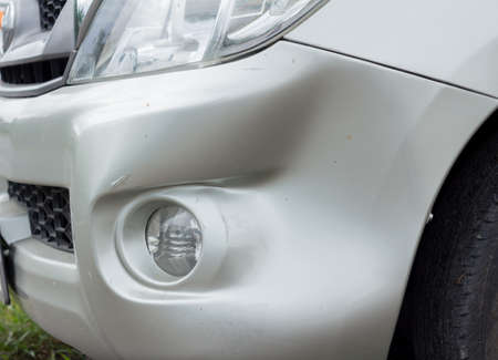A dent in the right front of a car