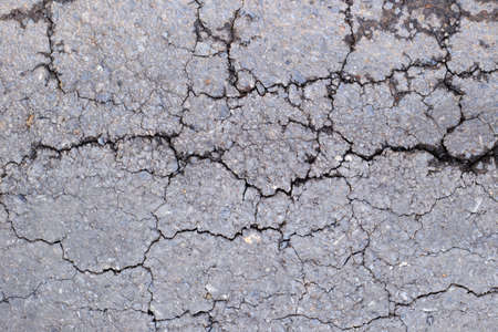 Asphalt texture with cracks Stock Photo