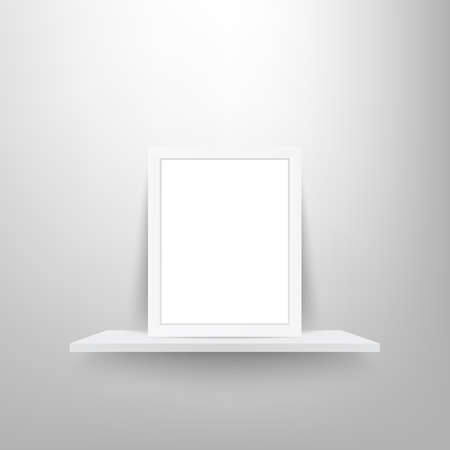 Picture frame on white shelf.
