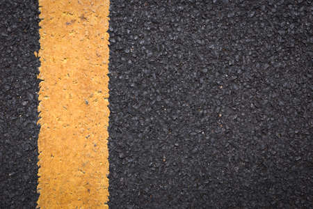 Asphalt road texture with lines.