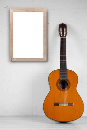 spanish guitar: Blank frame with Spanish guitar in room as background