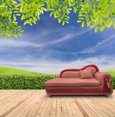 red sofa: Red sofa in garden Stock Photo