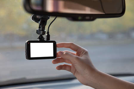 Dash cam on car windshield Stock Photo