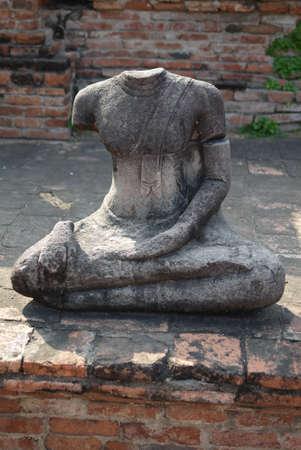 Headless damaged buddha in the ancient ayutthaya temple photo