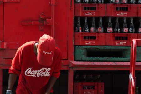 Saraburi, Thailand - Aug 12, 2012   Coca Cola Thai employee loading empty Coke glass bottles to the truck