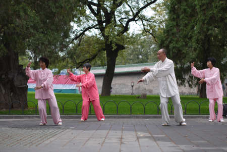 Beijing, China - Oct 14, 2013 : Unidentified people do Tai Chi in early morning at Temple of heaven public park in Beijing, China.