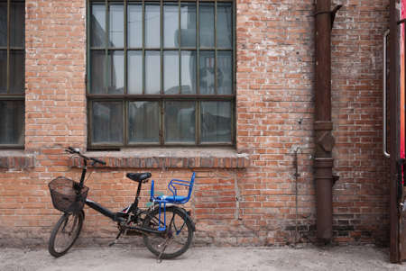 buiding: Old bicycle and the old red brick buiding background at 798 art district, Beijing, China