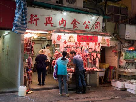gage: Hong kong, China - Nov 26, 2015 : Butchers shop in the gage street wet market lofts, Hong Kong Editorial