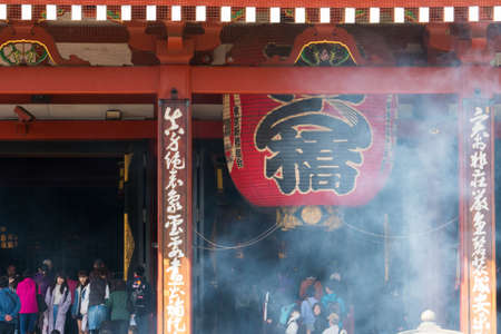 temple burn: Tokyo, Japan - Mar 22, 2016 - unidentified people visit sensoji temple and burn incenses full of smoke. Sensoji temple is the most famous attraction in Asakusa, Tokyo, Japan Editorial