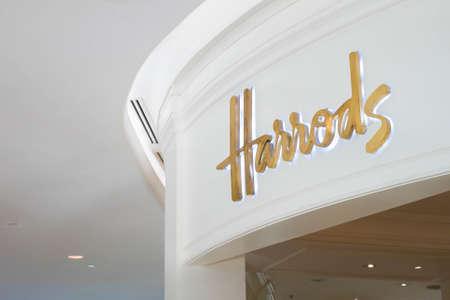 harrods: Bangkok, Thailand - May 8, 2016 : Gold sign logo at the entrance of the famous Harrods shop cafe bakery and restaurant at Central Embassy shopping mall in Bangkok.