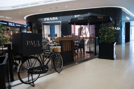 prada: Bangkok, Thailand - May 6, 2016 : Prada store and Paul bakery cafe at Central Embassy Shopping Mall in Bangkok, Thailand.