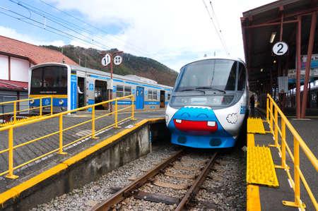 treno espresso: Yamanashi, Japan - Mar 19, 2016 : Fujisan Express train Fujikyu railway run from Otsuki station to Kawaguchiko station, was painted with Mount Fuji cute cartoon.