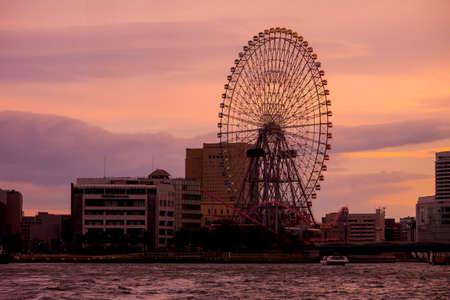 cosmo: Yokohama, Japan - Mar 18, 2016 : Cosmo Clock 21, a Ferris Wheel at sunset in MInato-Mirai, Yokohama, Japan. Editorial