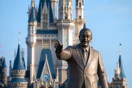 statuary: Tokyo, Japan - Mar 21, 2016 : Statue of Walter Disney infront of the Tokyo disneyland castle, Tokyo, Japan.