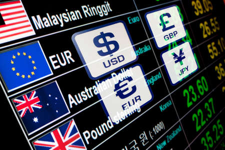 currency icons signs exchange rate on digital display board Stock Photo