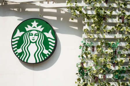 starbucks: Bangkok, Thailand - Dec 20, 2015 : Exterior view of a Starbucks store Drive Thru and logo in Bangkok, Thailand. Starbucks is the worlds largest coffee house with over 20,000 stores in 61 countries.