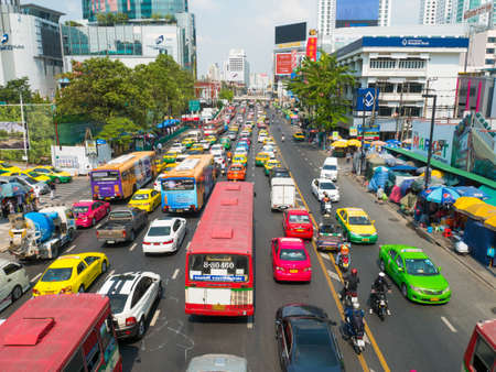 standstill: Bangkok, Thailand - JAN 30, 2016 : Daily traffic jam in the afternoon at Ratchaprasong Junction, Central World shopping mall, Bangkok, Thailand. Editorial