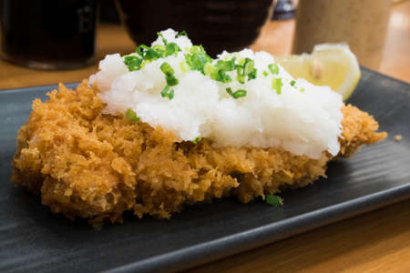 deep fry: Tonkatsu serve with grated radish. Deep Fires pork loin made by pork with bread crumb deep fry