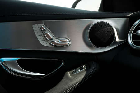 vintage cars: Door seat adjust button switch control in luxury business car
