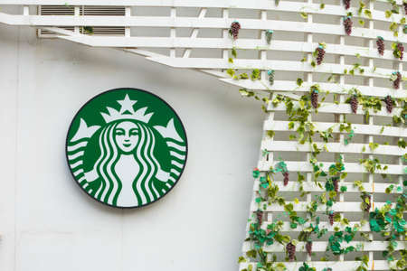 starbucks: Bangkok, Thailand - April 17, 2016 : Exterior view of a Starbucks store Drive Thru and logo in Bangkok, Thailand. Starbucks is the worlds largest coffee house with over 20,000 stores in 61 countries.