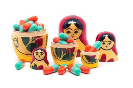 babushka: Russian Babushka nesting dolls and orange green capsules