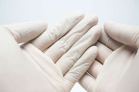 sterile: disposable sterile white gloves on white background Stock Photo
