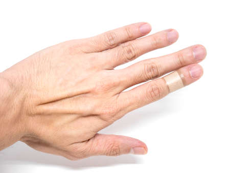 Adhesive Healing plaster on asian man finger for first aid concept