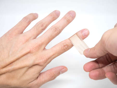 first finger: Adhesive Healing plaster on asian man finger for first aid concept