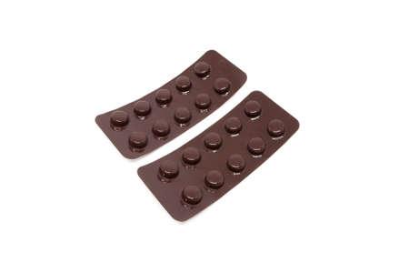 packs of pills: two brown blister packs pills protect light for stability Stock Photo