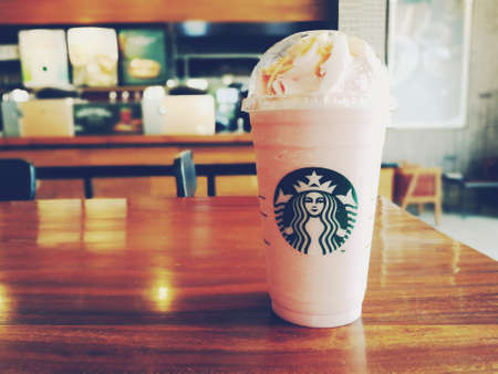 Bangkok, Thailand - July 30, 2017 : A glass of Starbucks coffee blended beverages, Caramel cream frappuccino with raspberry syrup and strawberry whipped cream. Editorial