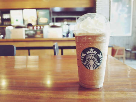 Bangkok, Thailand - July 30, 2017 : A glass of Starbucks coffee blended beverages, Mocha caramel frappuccino. (vintage color)