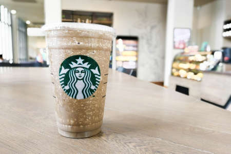 Bangkok, Thailand - Aug 26, 2017 : A cup of Starbucks coffee blended beverages, Hojicha (roasted Japanese green tea) frappuccino. Editorial