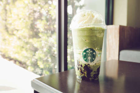 Bangkok, Thailand - June 17, 2017 : A cup of Starbucks Green tea Matcha frappuccino with earl grey jelly at Starbucks coffee shop in Bangkok, Thailand. (Vintage color photography) Editorial