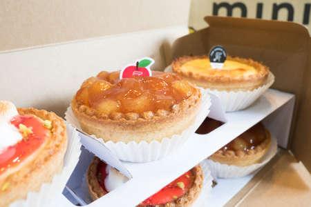 Bangkok, Thailand - April 14, 2017 : Pablo mini apple cinnamon cheese tart, the famous cheese tart from Osaka, Japan.