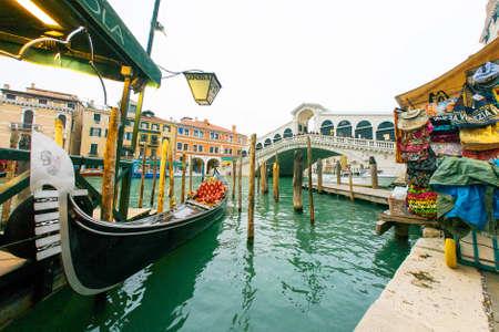 Venezia, Italy - Mar 7, 2017 :  Gondola with famous Rialto bridge cross grand canal, Venice, Italy