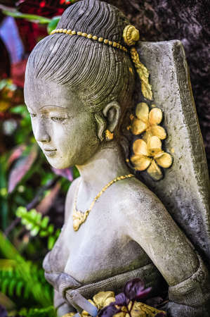sword act: woman statue in thailand