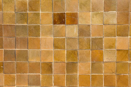 stone wall texture: Yellow square tile wall background Stock Photo