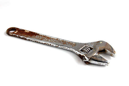 crescent wrench: Adjustable wrench placed on white background