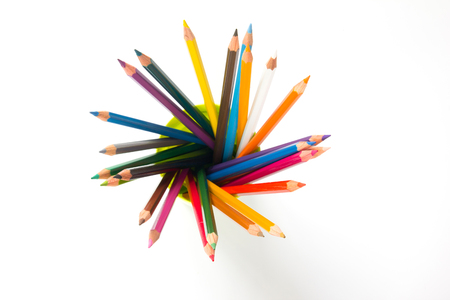 disrupt: Color pencil placed on white background