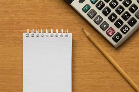 calculate: Calculator, notebook and pencil for calculate