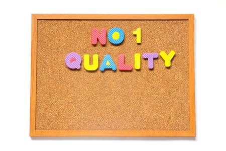 no1: Corkboard with wording no.1 quality placed on white background Stock Photo