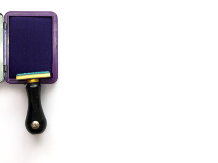 secretary tray: Black wooden rubber stamp with violet ink tray on white background Stock Photo