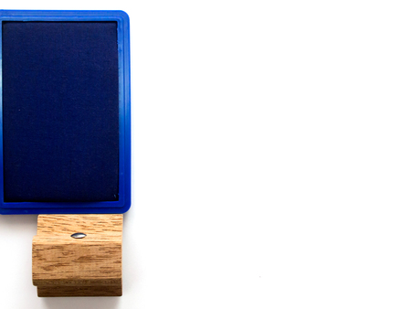 secretary tray: Wooden rubber stamp with blue ink tray on white background