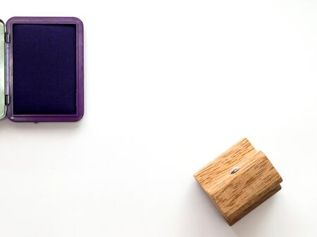 secretary tray: Wooden rubber stamp with violet ink tray on white background Stock Photo
