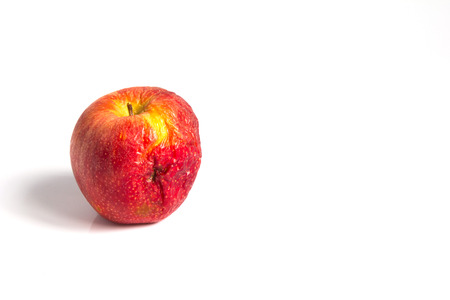 Wizen apple presented as old aging skin Stock Photo